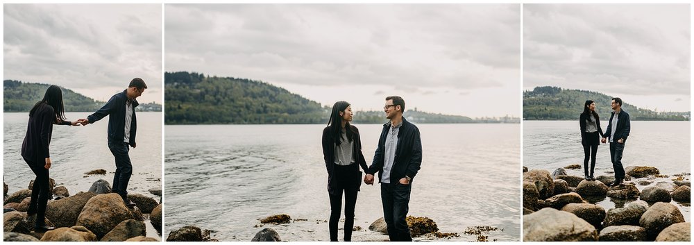 couple on beach rocks sunset north vancouver engagement session