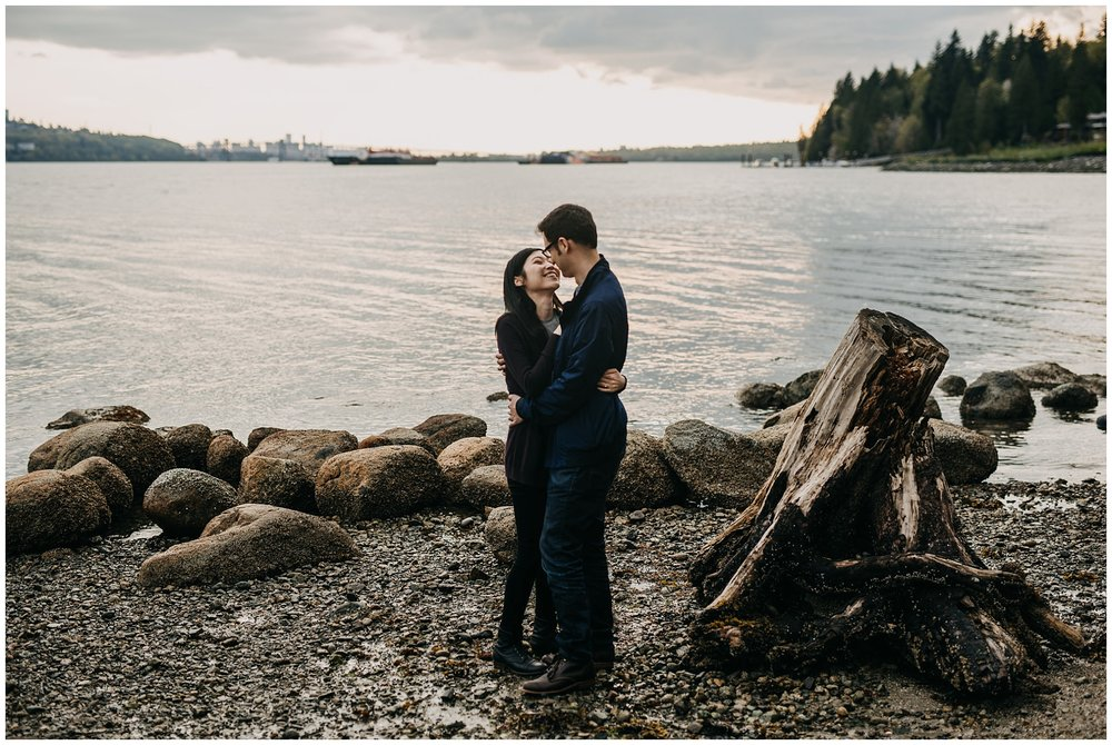 sunset north vancouver cates park engagement session couple kissing