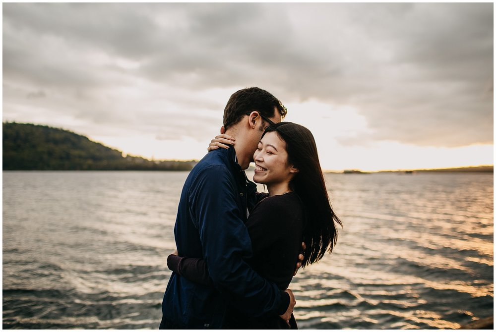 couple on dock north vancouver engagement golden sunset windy