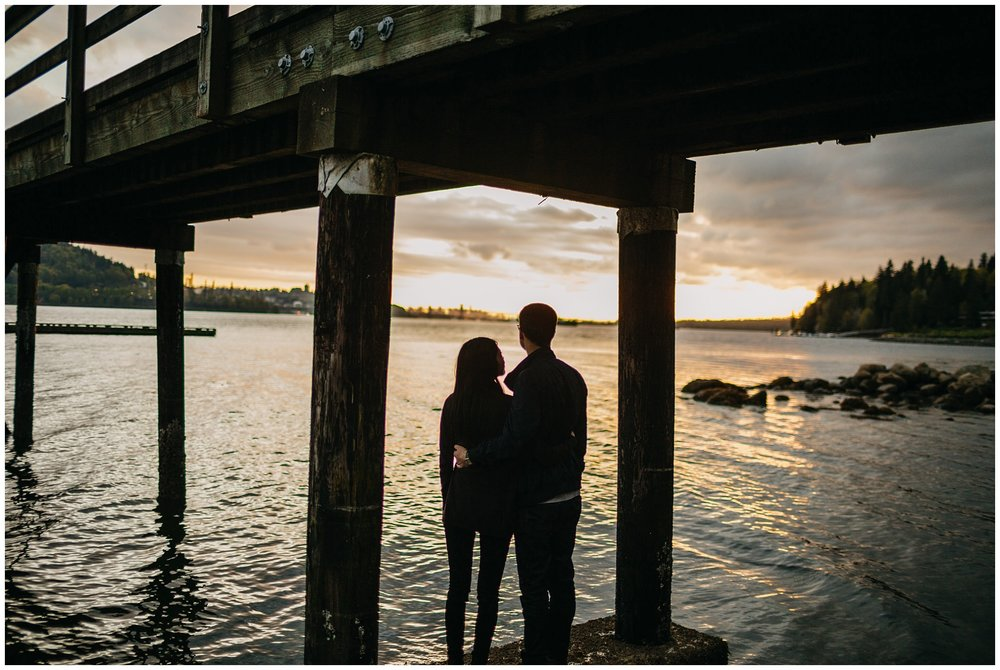 couple silhouette sunset vancouver beach engagement