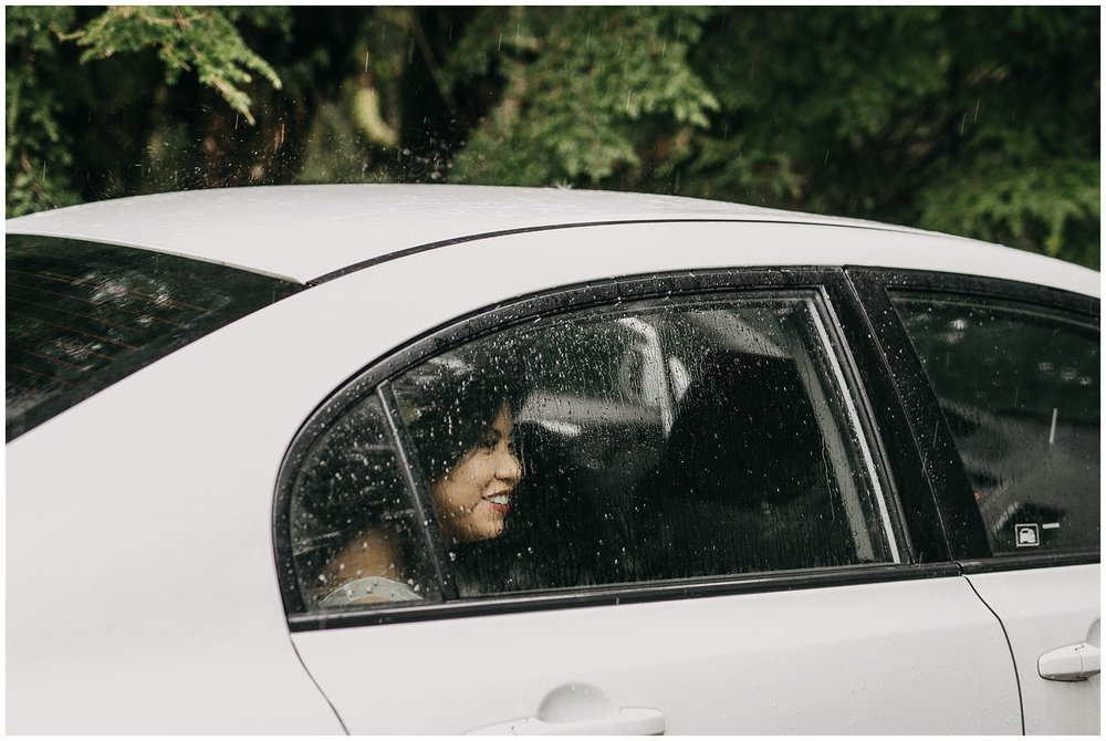 bride in car rain on glass window pnw golden ears intimate wedding
