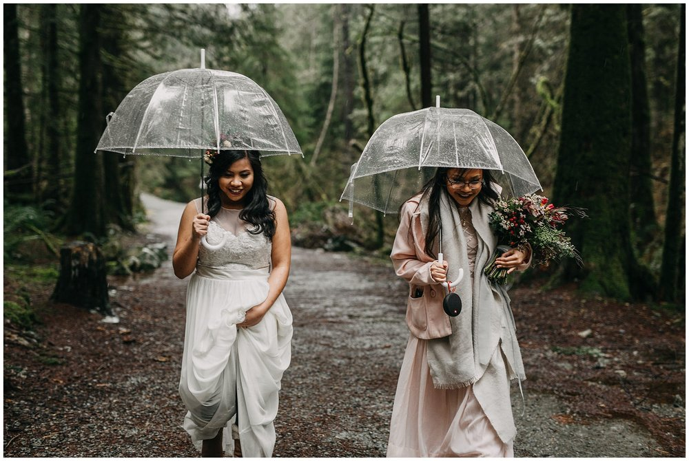 bride walking in forest rainy day wedding intimate wedding