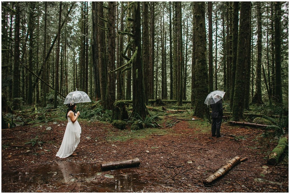 bride groom first look in forest golden ears intimate rainy wedding
