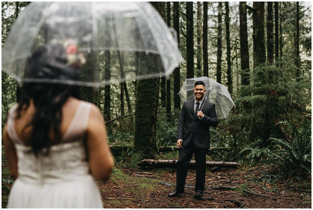 first look groom's reaction rainy forest intimate wedding golden ears