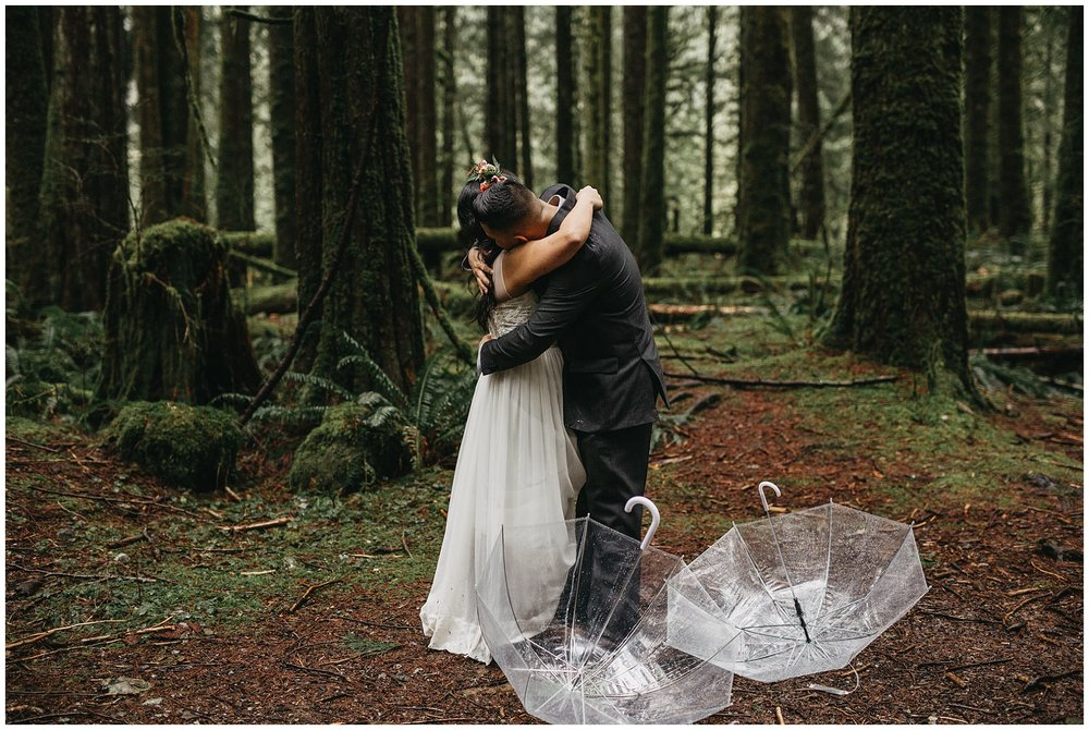 bride groom hug after first look rainy intimate forest wedding golden ears
