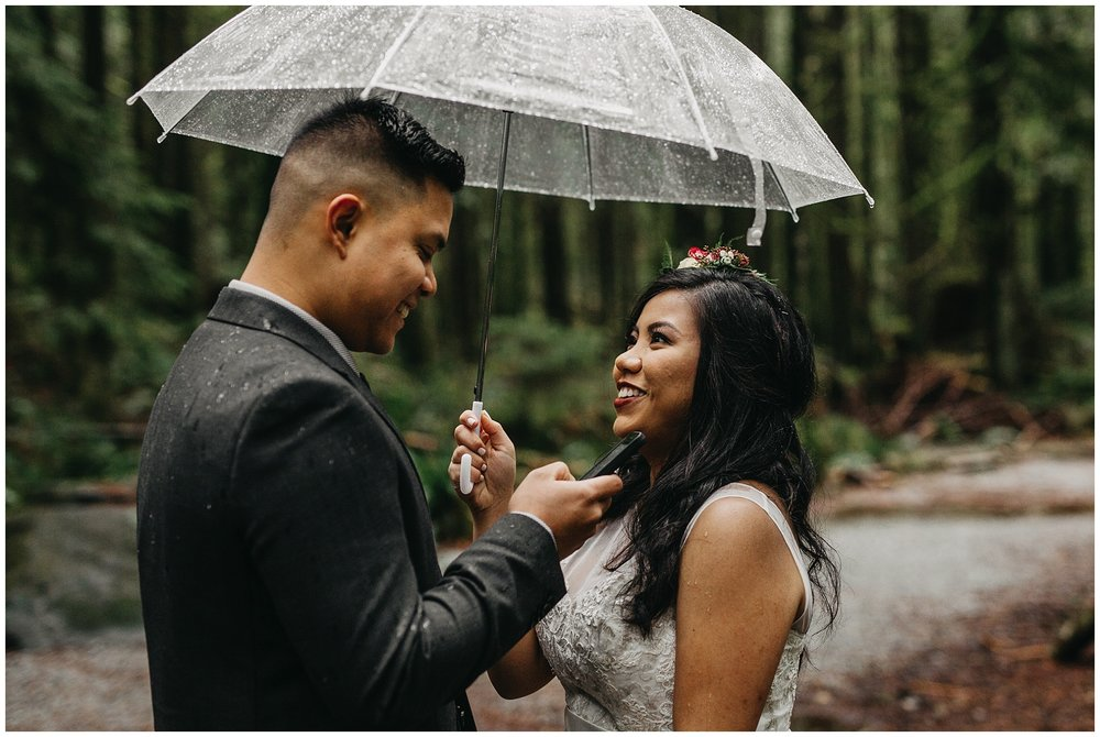 bride's reaction to groom's vows in forest intimate golden ears park wedding
