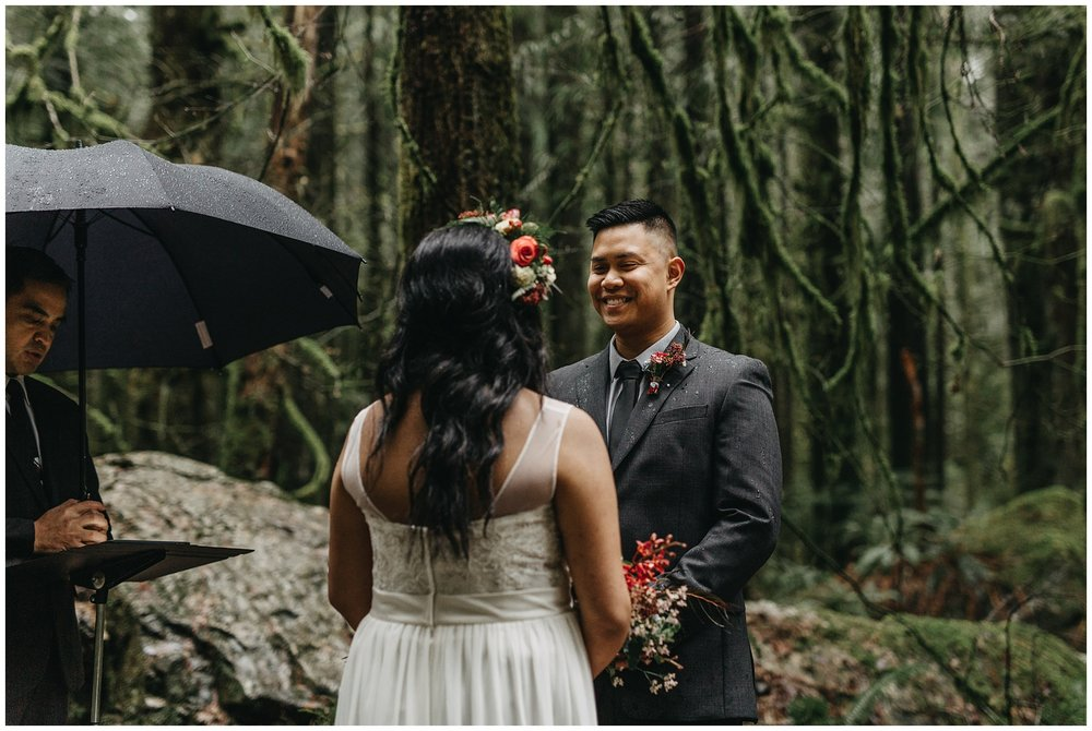 groom happy ceremony intimate wedding forest golden ears rainy pnw day