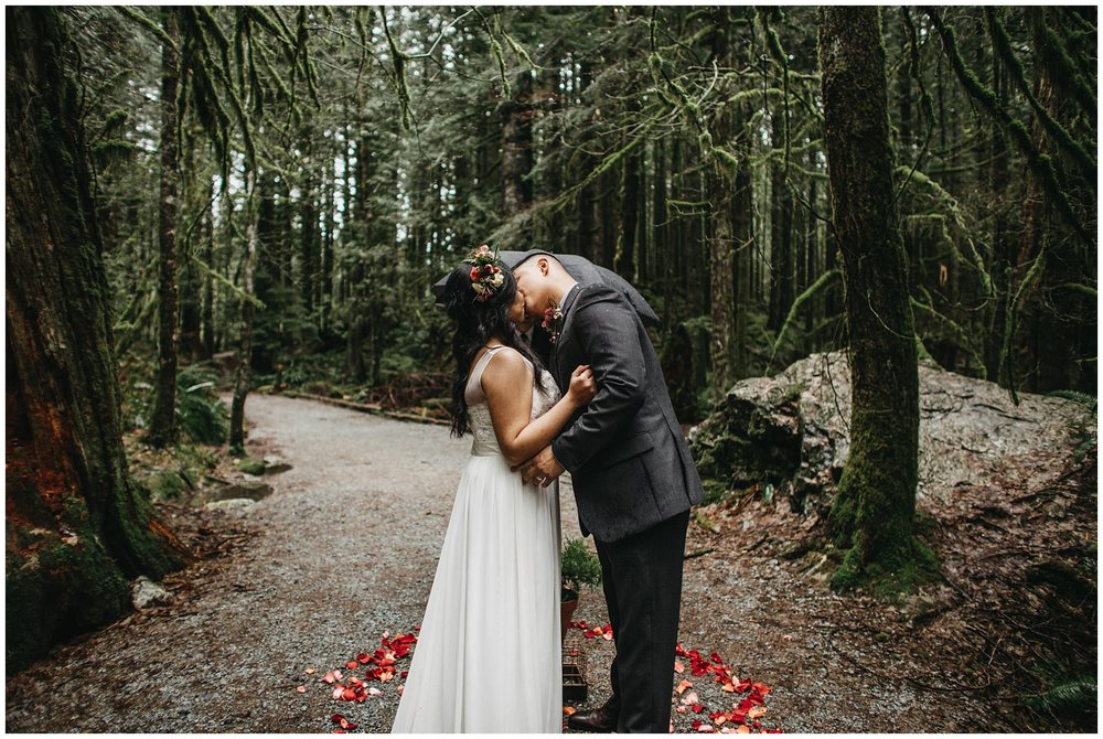 wedding couple kiss ceremony bride groom intimate forest golden ears wedding