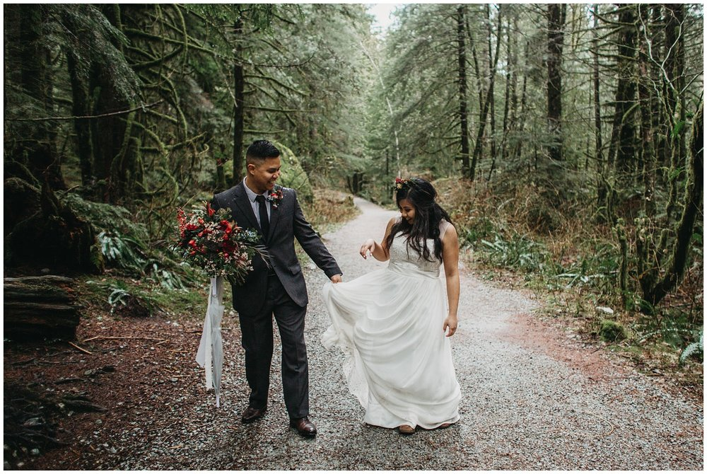 wedding couple bride groom playful dress bouquet forest intimate wedding