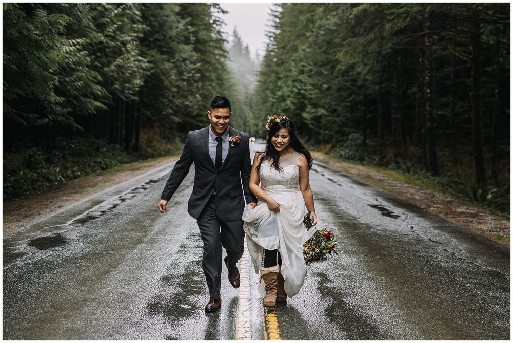 bride groom portrait running on wet rainy road golden ears park intimate wedding