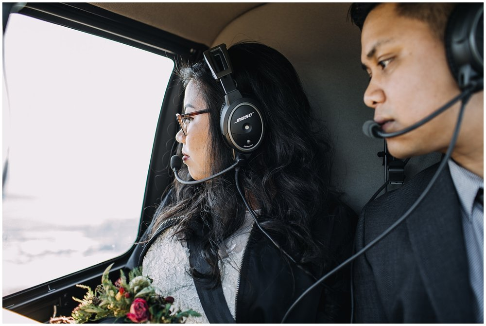 bride groom riding in helicopter mountaintop wedding portraits