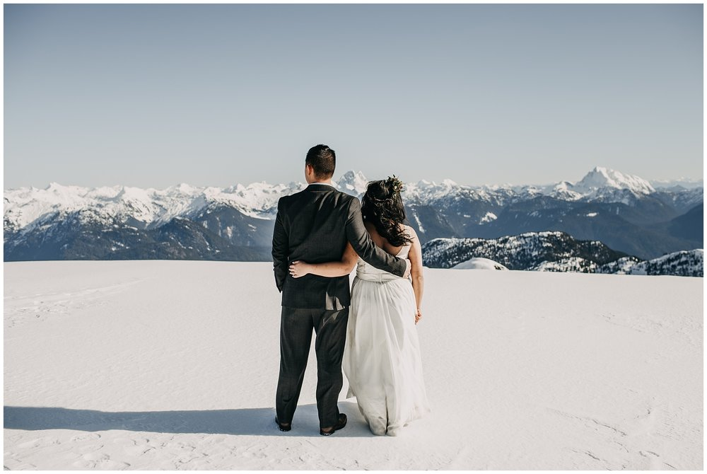 bride groom sky helicopters mountaintop snow sun wedding portraits
