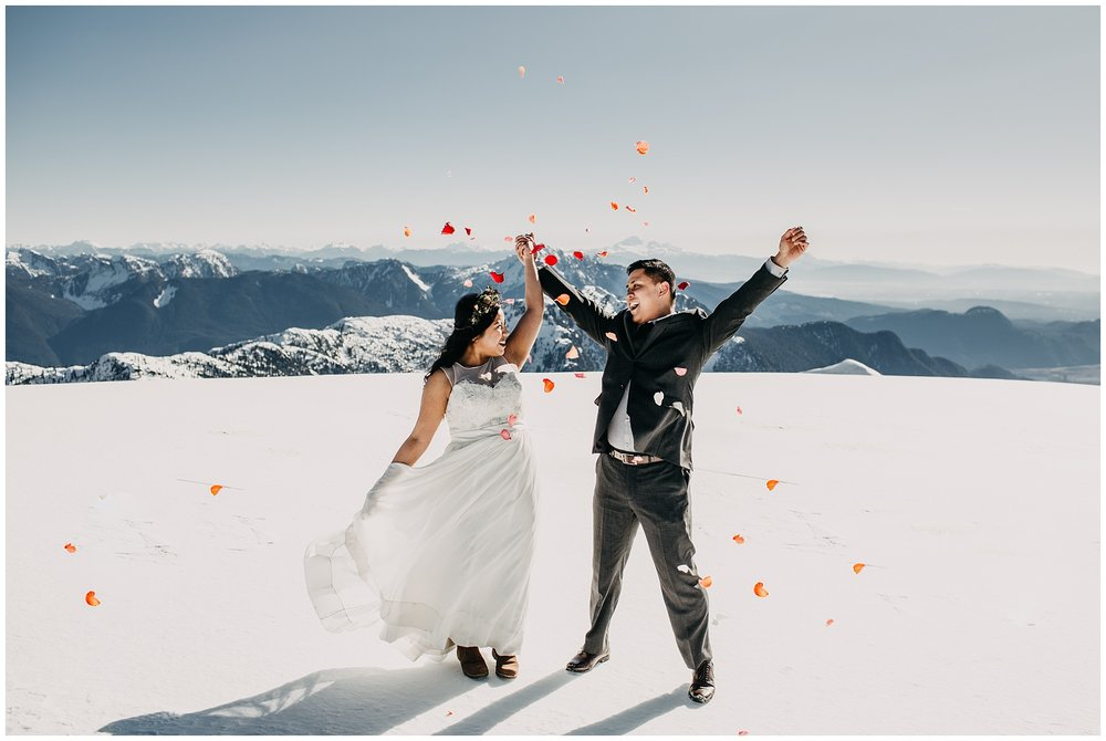 bride groom confetti mountaintop snow sky helicopters wedding cheer