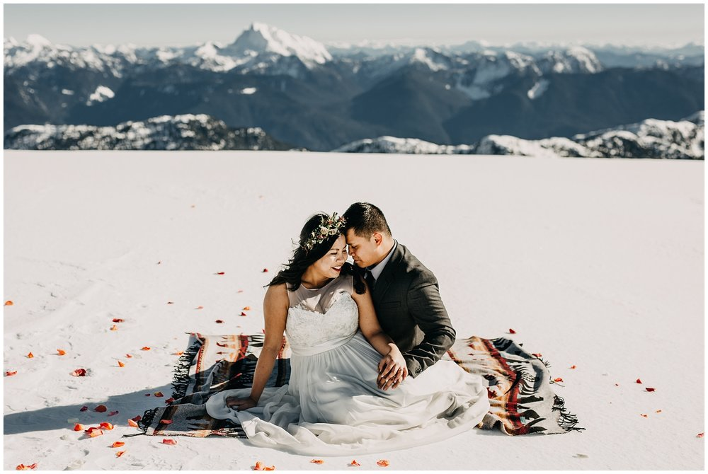 bride groom mountaintop portraits wedding sky helicopters florals sackcloth and ashes blanket