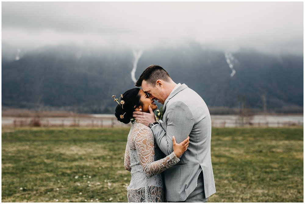 bride and groom first look reaction at fraser river lodge wedding with mountain backdrop