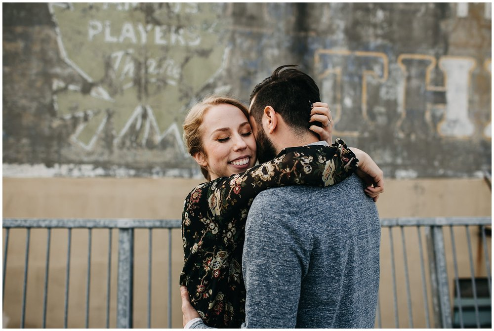 couple hugging on rooftop parkade at downtown new west engagement session