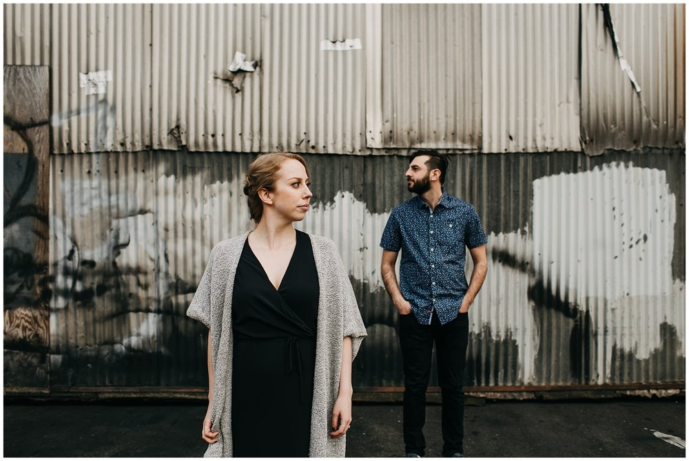 couple in industrial urban setting at downtown new west engagement session