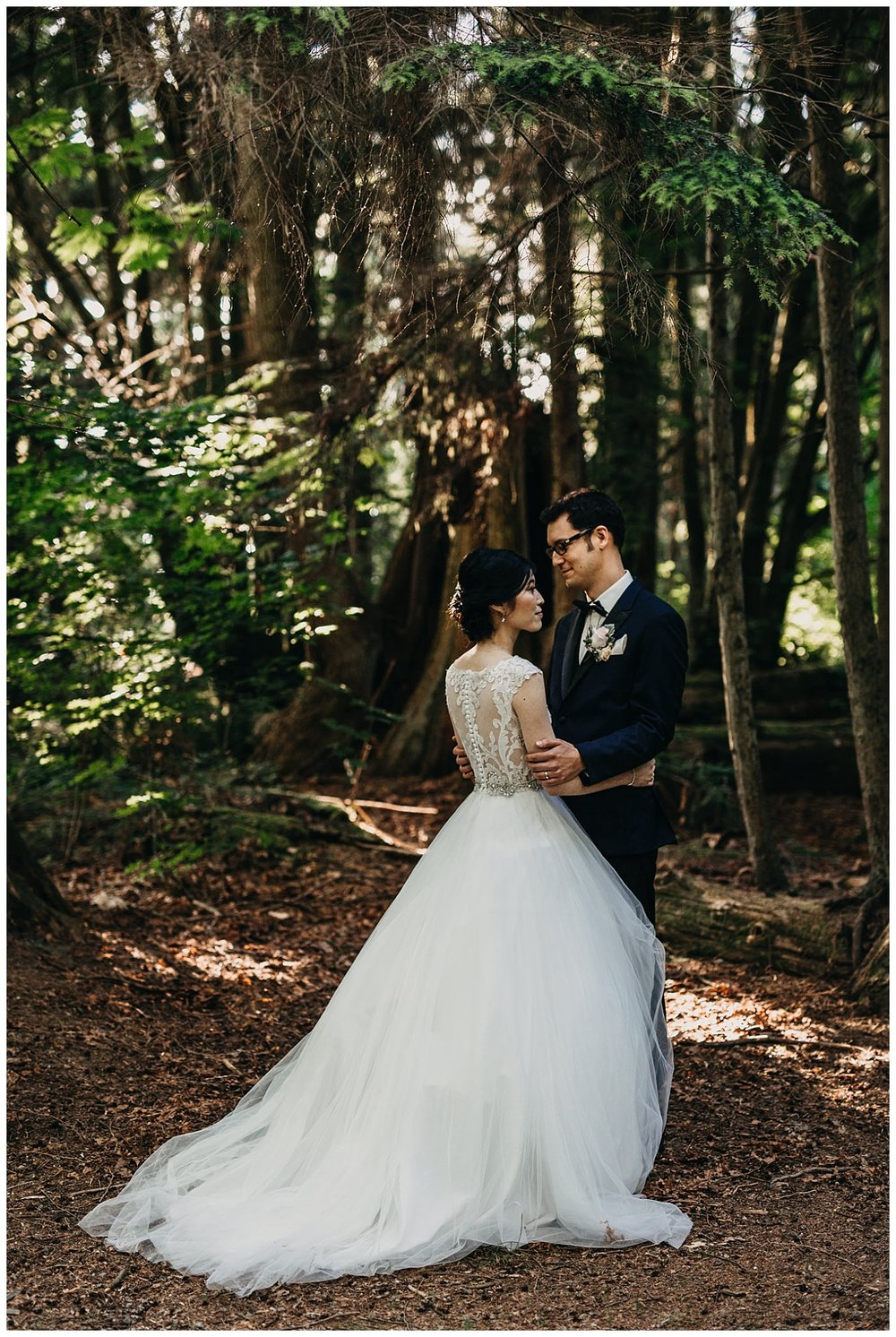 bride and groom portrait in the forest at stanley park teahouse wedding