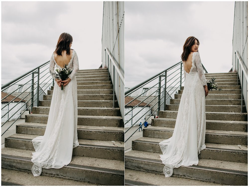 bride portrait at granville island on emily carr stairs
