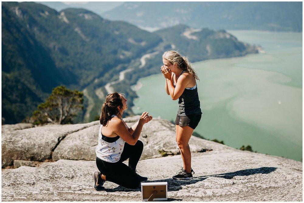 same sex couple proposal on the chief hike peak in squamish bc