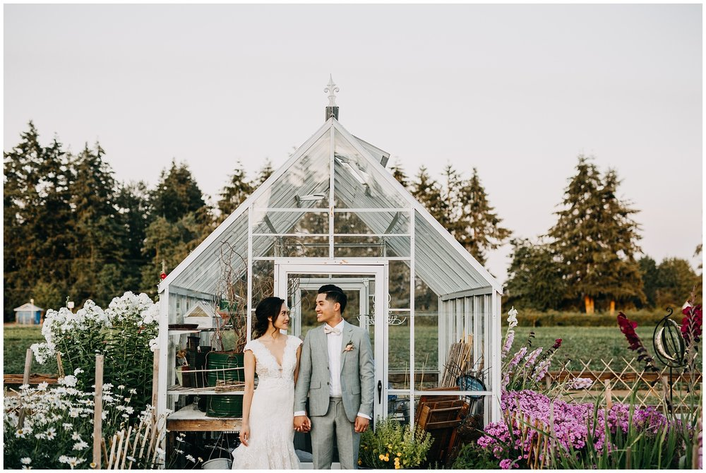 bride and groom greenhouse portrait at krause berry farm wedding