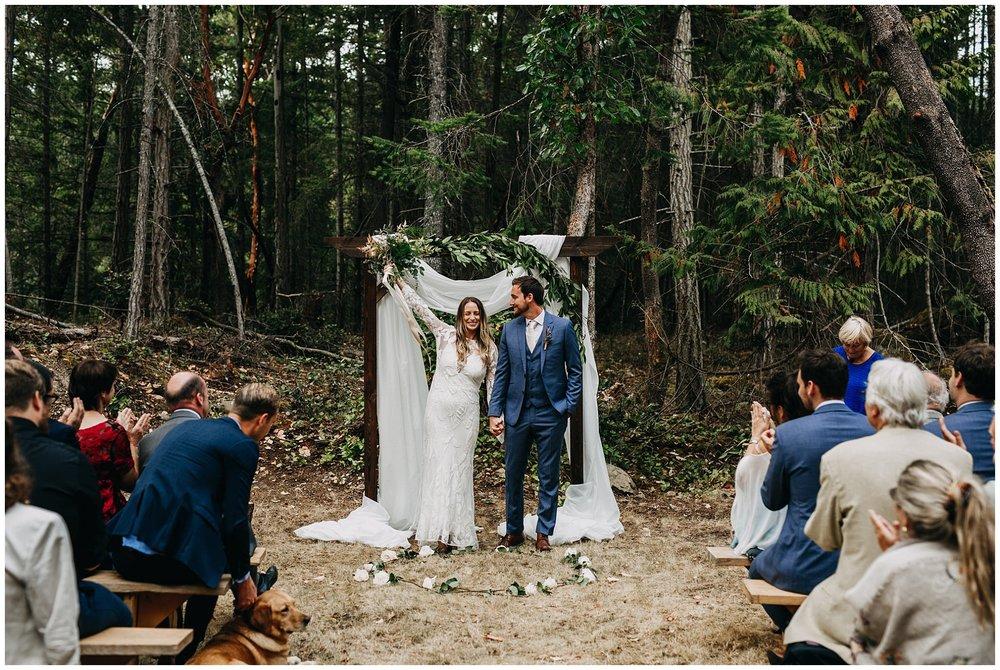 bride and groom ceremony exit at intimate mayne island backyard wedding