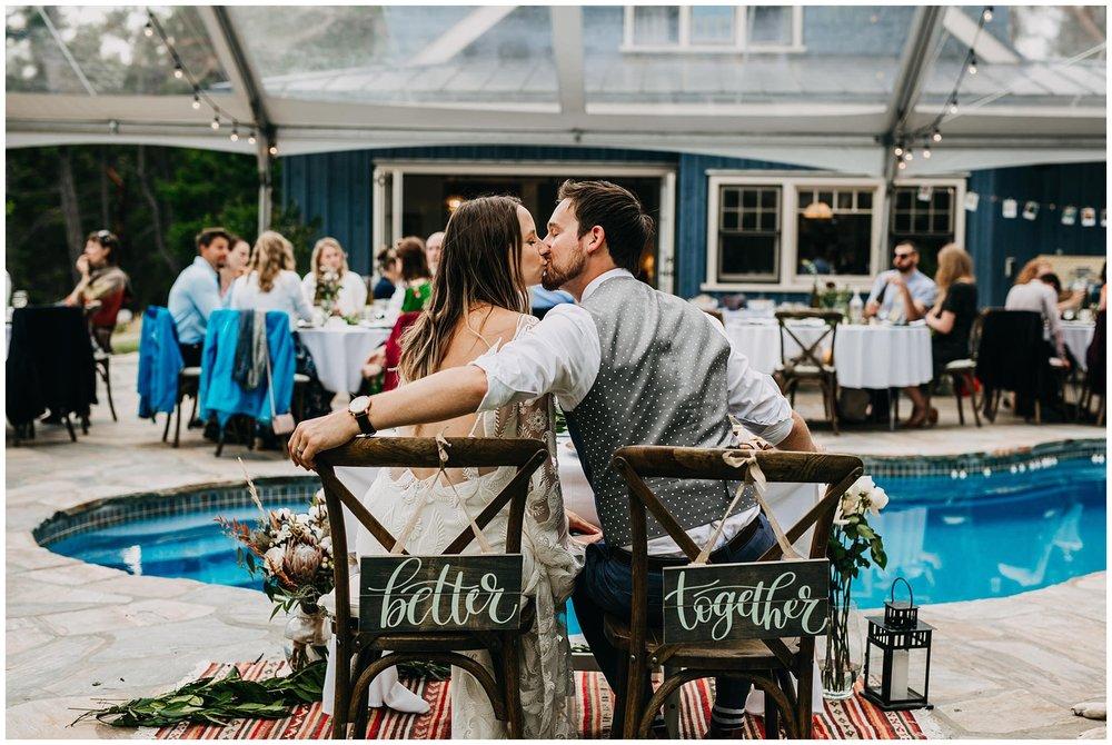 bride and groom kissing at mayne island backyard wedding reception