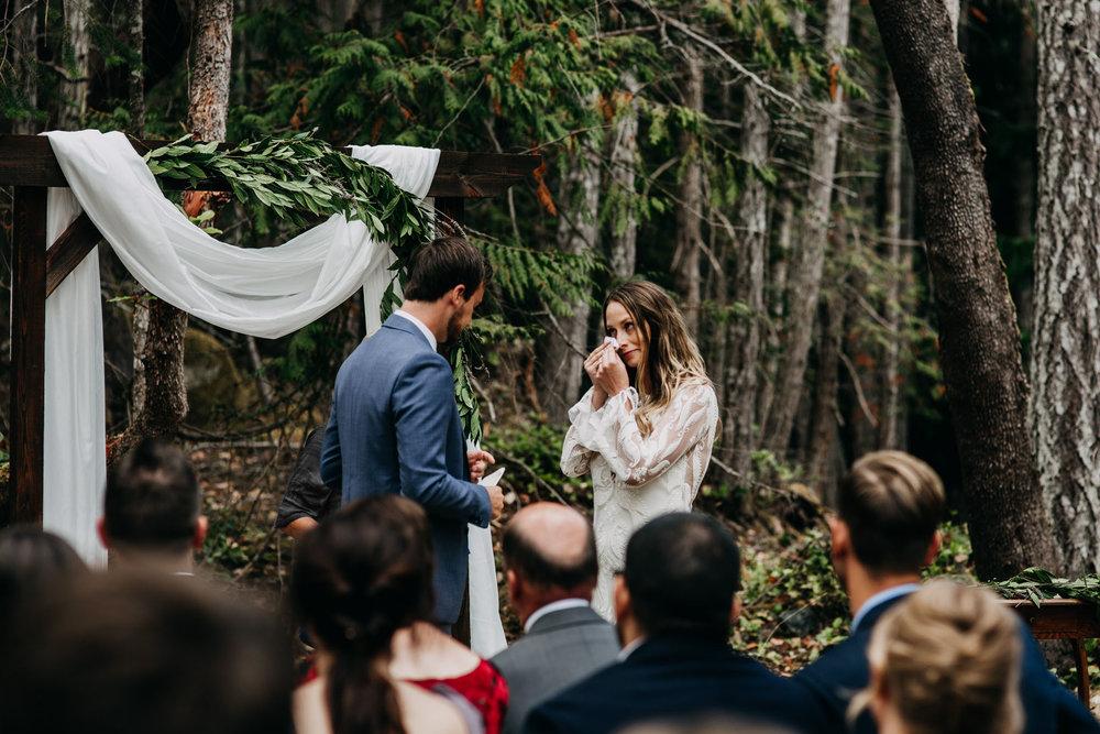 bride crying during vows at intimate mayne island backyard wedding