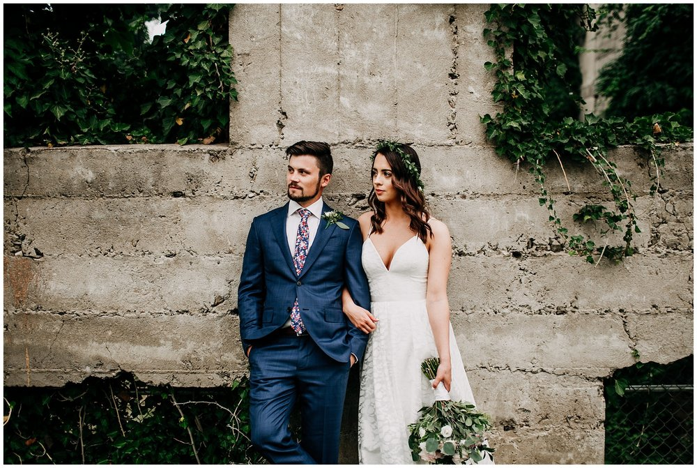 bride and groom portrait at abandoned hotel in kelowna