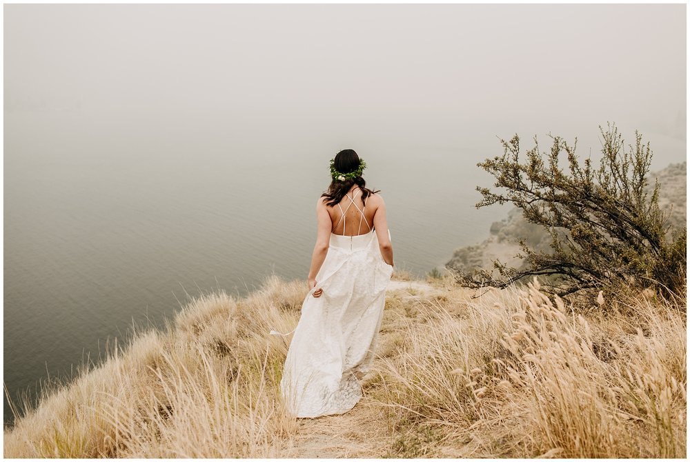 bride walking to viewpoint at linden gardens wedding in kelowna