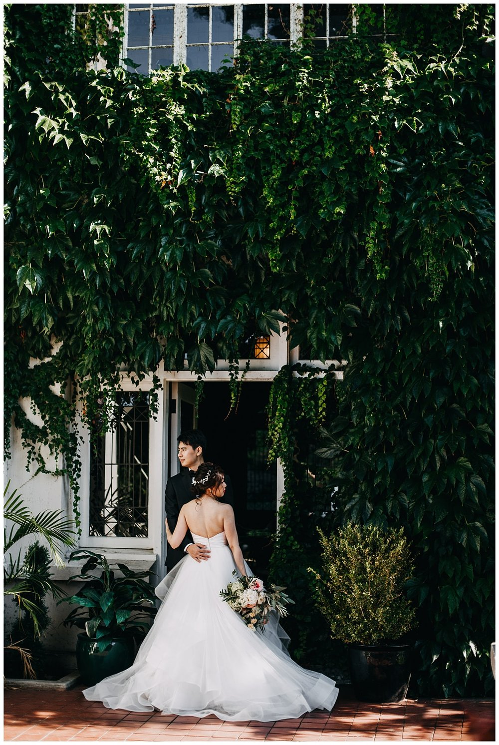bride and groom portrait in front of ivy wall at hycroft manor wedding