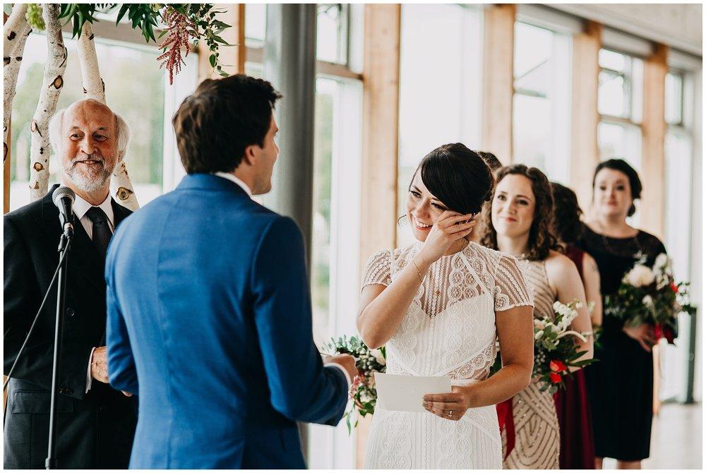 bride crying at ubc boathouse wedding ceremony