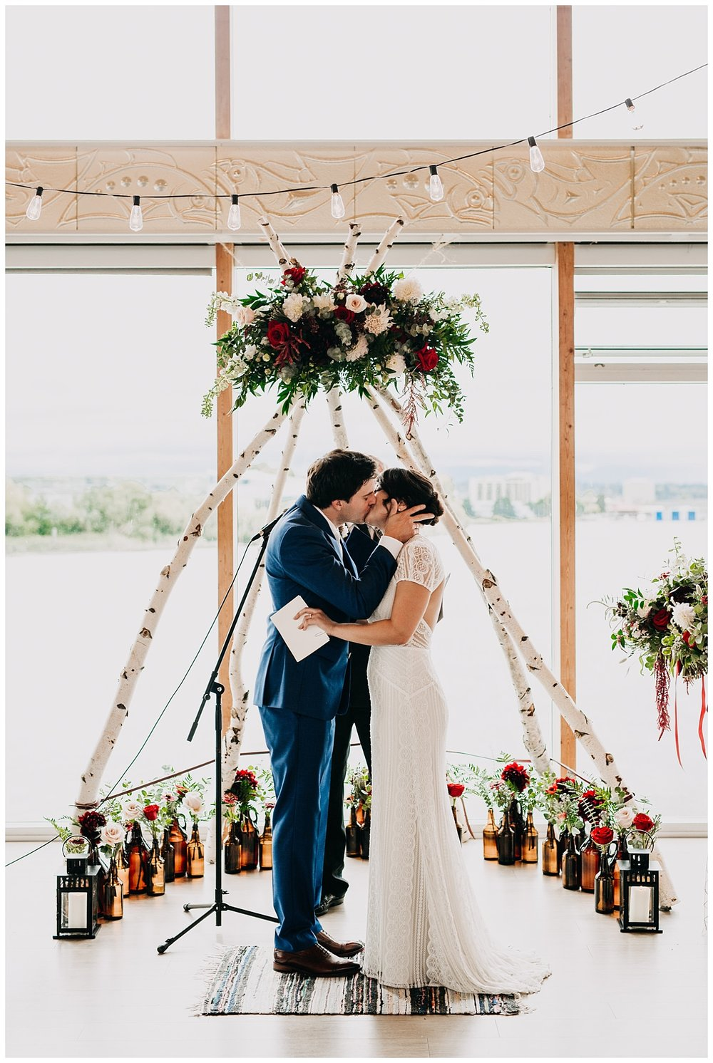 bride and groom first kiss at ubc boathouse wedding ceremony