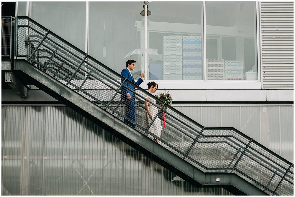 bride and groom walking down stairs at ubc boathouse wedding
