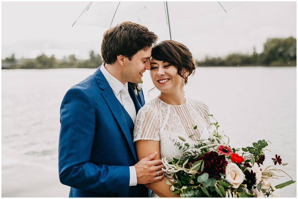 bride and groom portrait in the pnw rain at ubc boathouse wedding