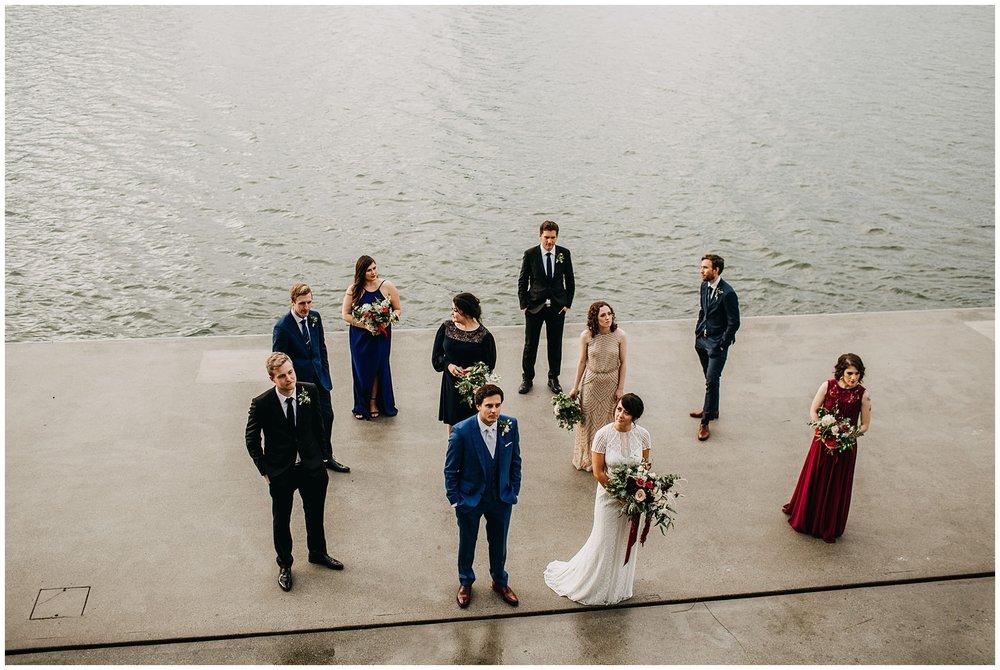 wedding party portrait at rainy ubc boathouse wedding