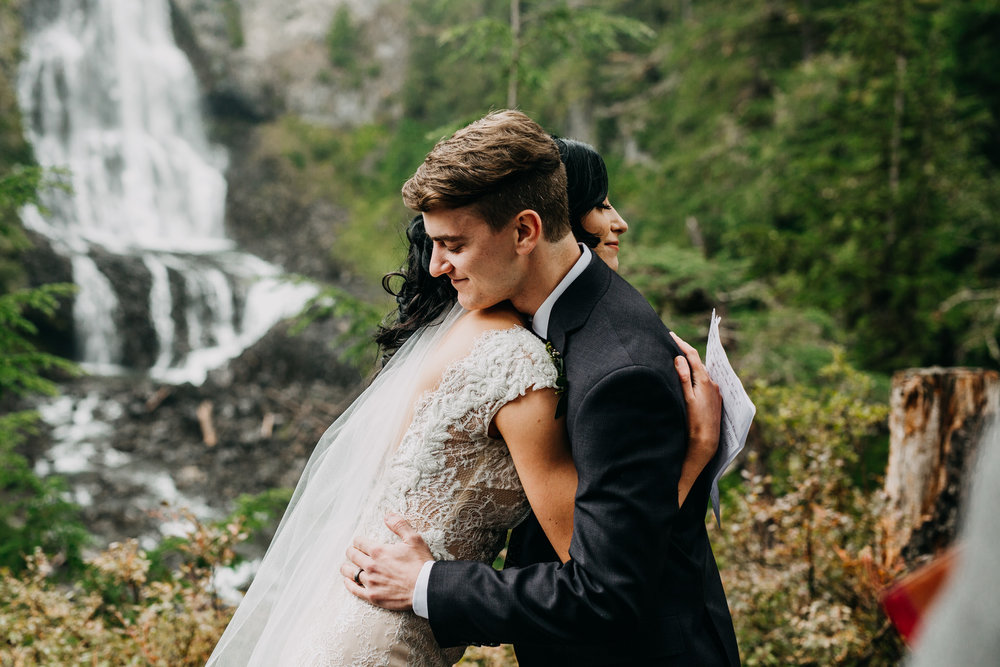 bride and groom hugging at whistler elopement