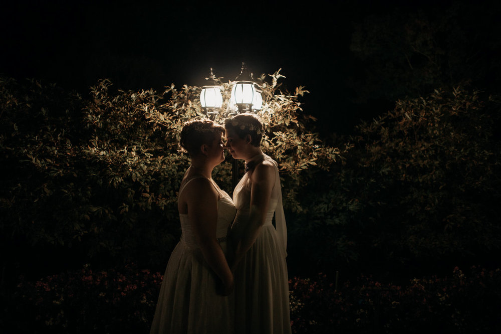 same sex couple night time portrait at vancouver wedding