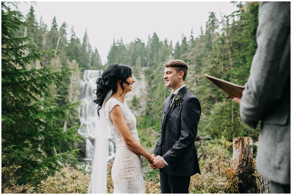 bride and groom in front of waterfall at whistler elopement