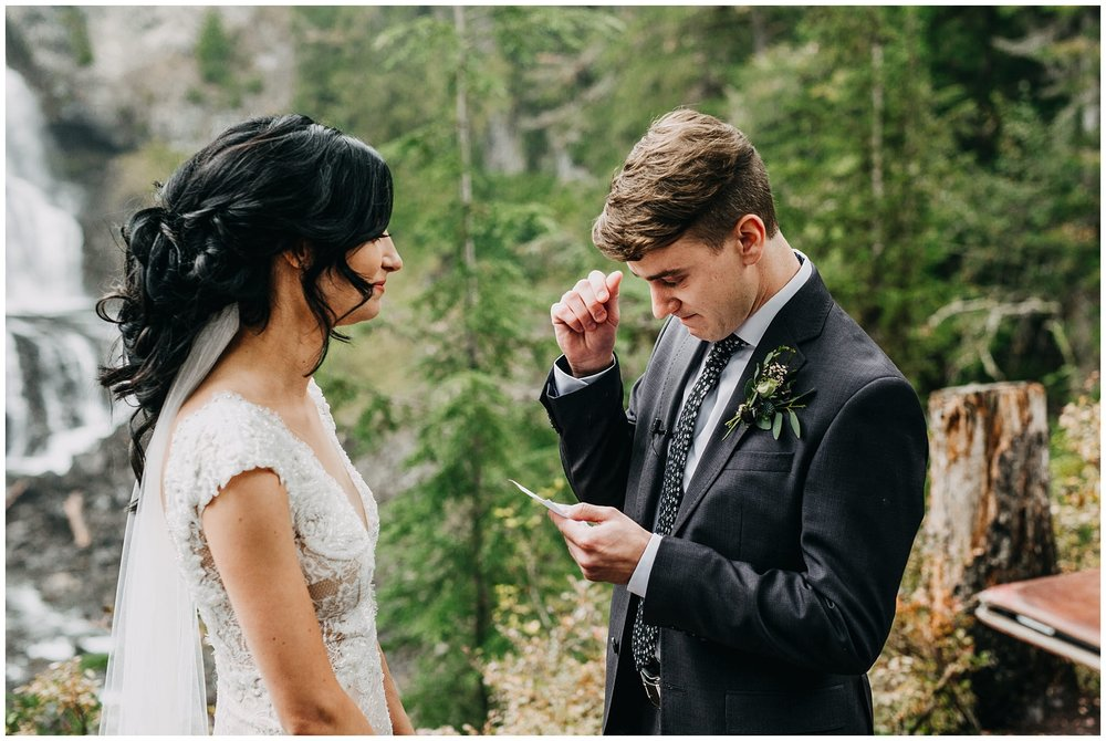 bride and groom exchanging vows at whistler elopement