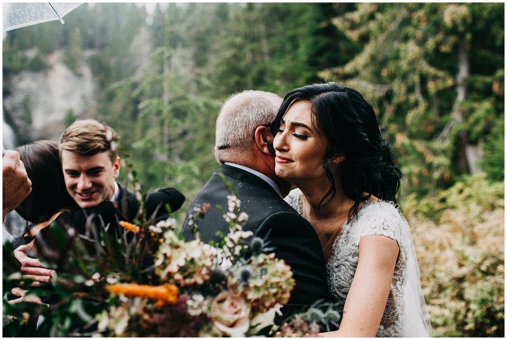 emotional moment of bride hugging father