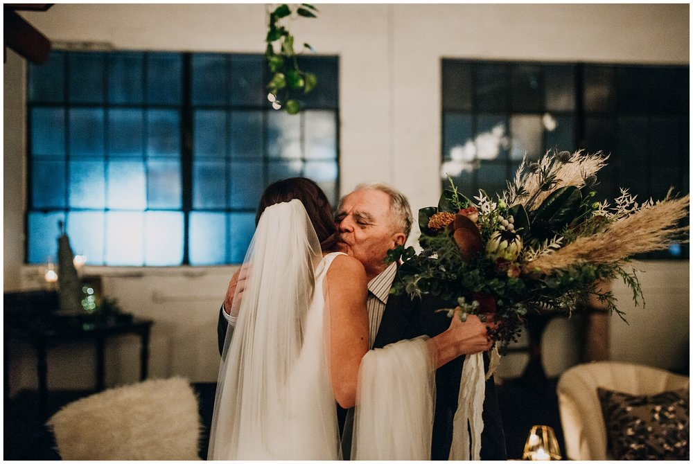 candid moment between bride and grandfather at settlement building