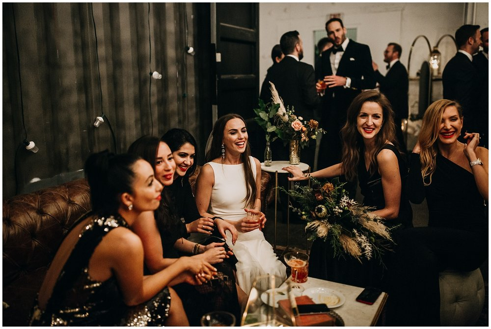 bride with girlfriends at new years eve settlement building wedding