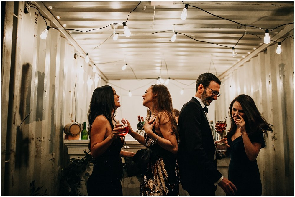 candid moment of bride at bar at settlement building wedding