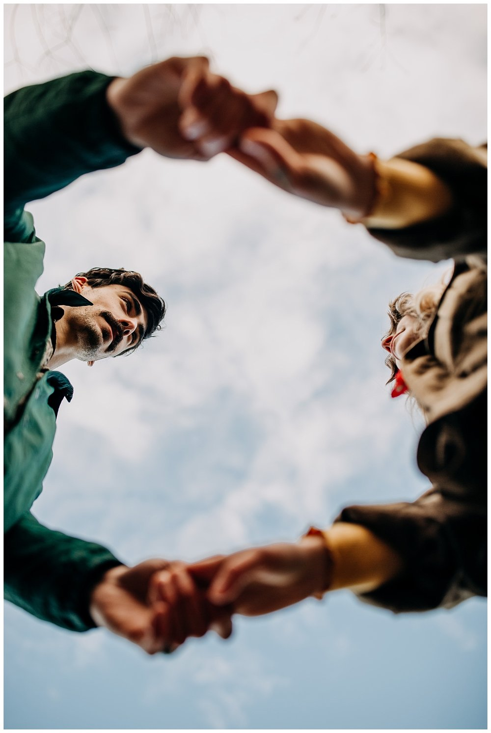 creative perspective of couples hands at jericho beach engagement session
