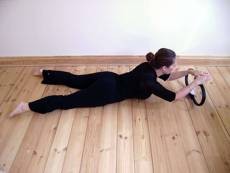 Pilates Cobra exercise with Magic Circle