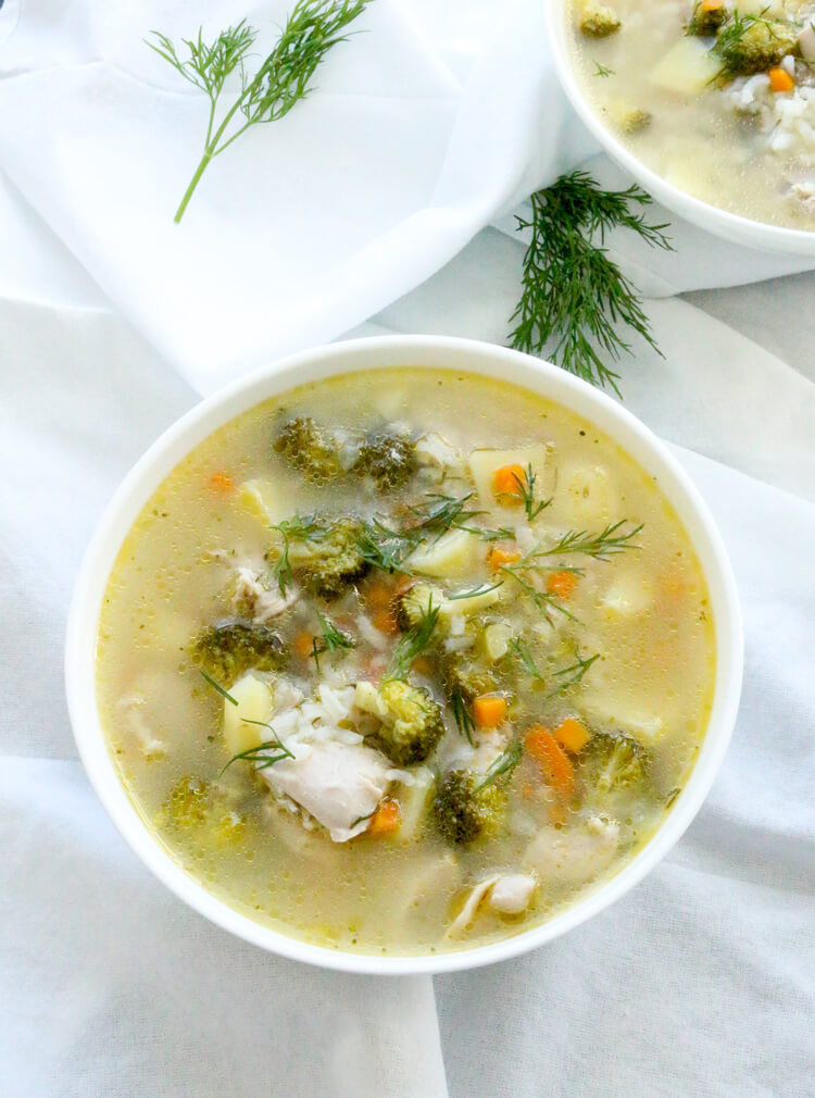 A bowl of chicken, rice and vegetable soup.