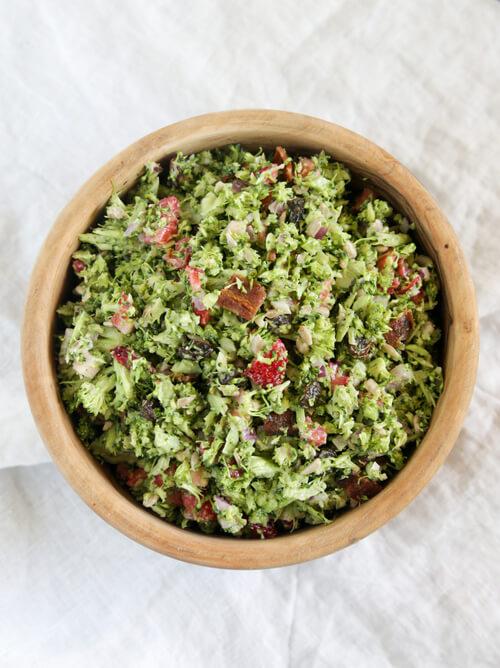 A bowl of broccoli salad with greek yogurt dressing