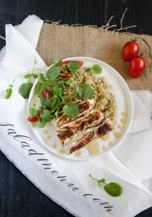 A plate full of Cajun Halibut with Sprouted Quinoa and Watercress