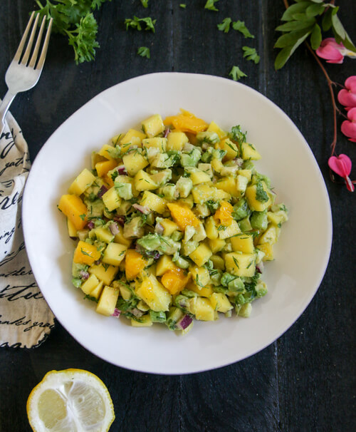 A plate of mango and avocado salad